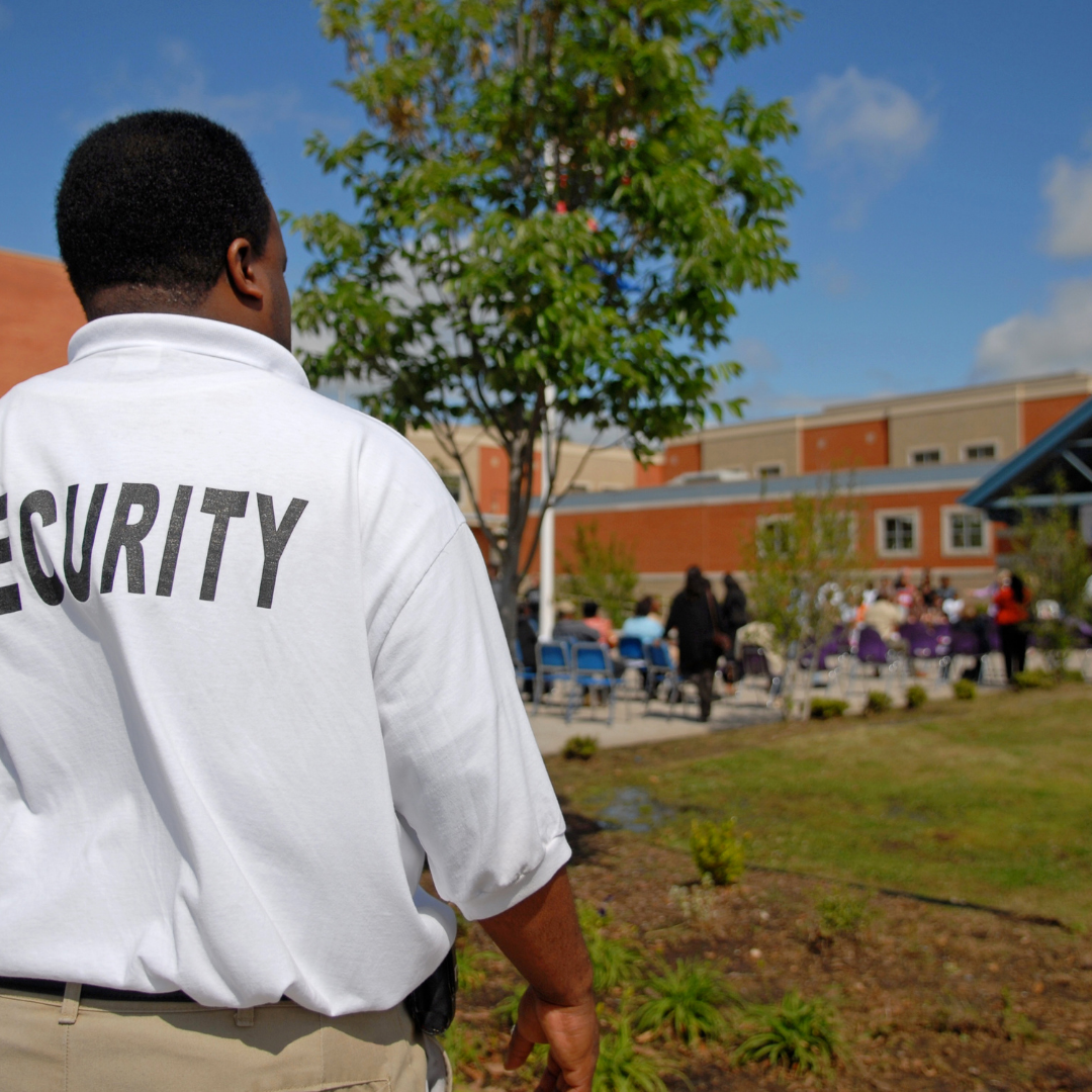 security guard in front of school, Security Guards Training Guide